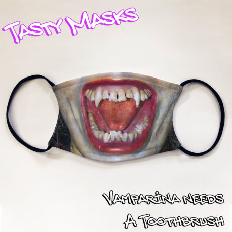 Facemask of vampire mouth wide open bearing fangs, with red lipstick