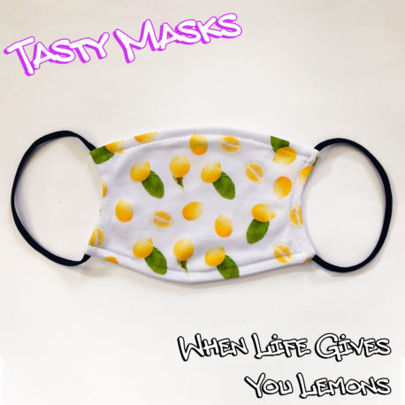 Facemask white background, images across front of lemons, some whole, some half, some with leaves attached