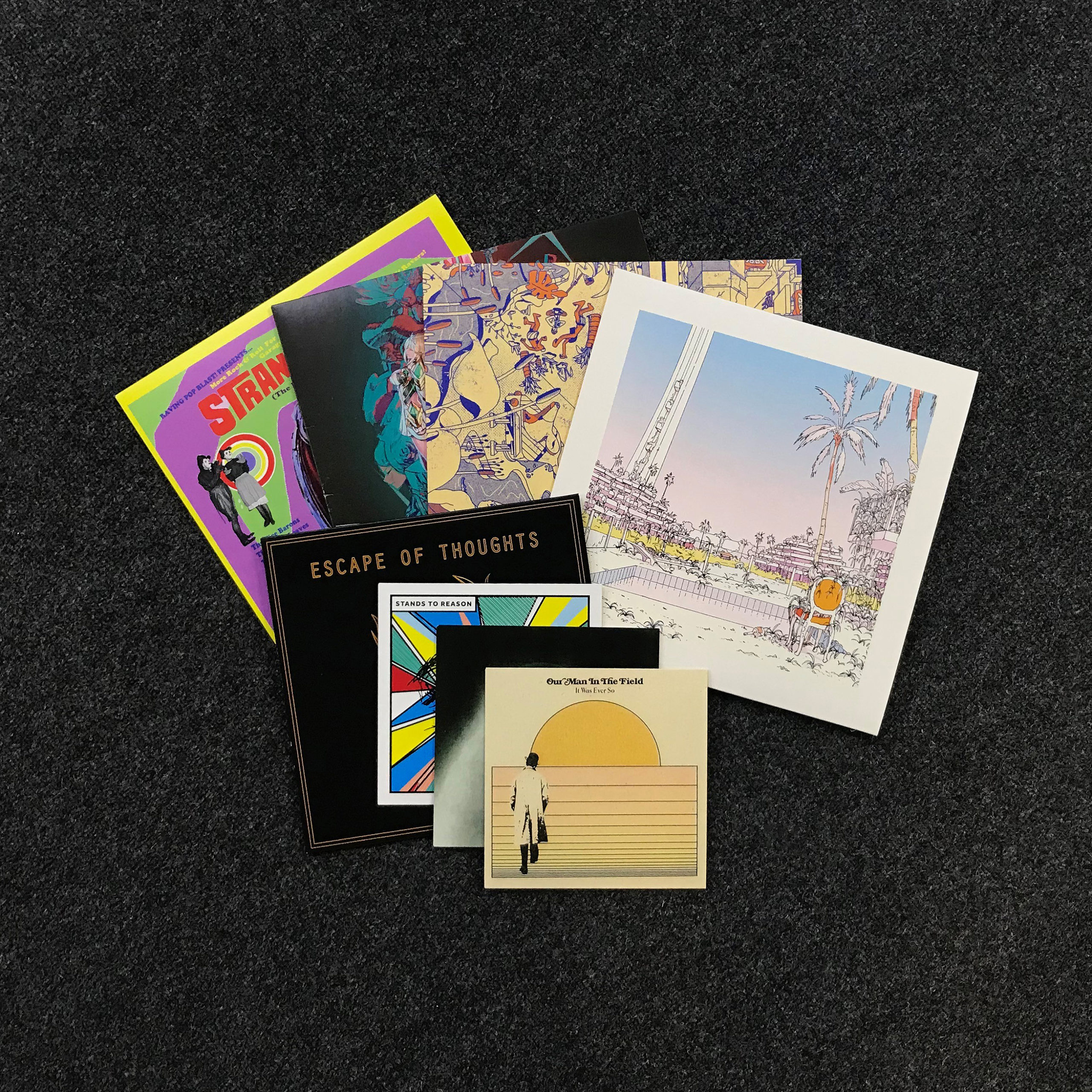 Example photograph of printed record sleeves in various sizes